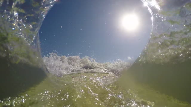 POV of a surfer surfing waves on his longboard log surfboard. - Slow Motion