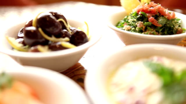 a table of jordanian mezze in petra - dipping stock videos & royalty-free footage