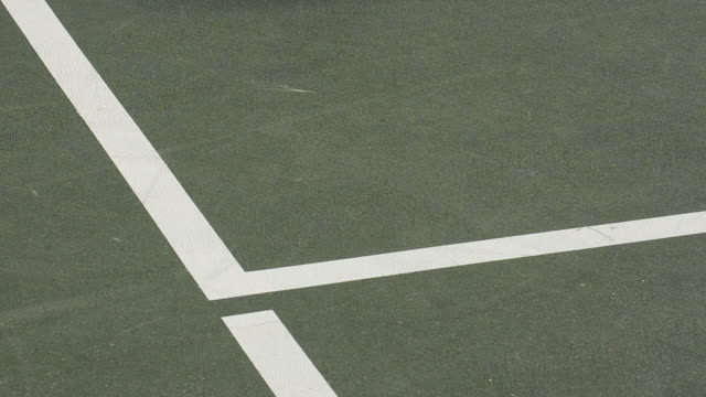 cu ecu of a tennis ball hitting inside the lines. - tennis ball stock videos & royalty-free footage