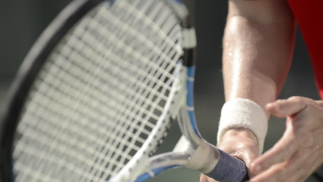 cu ecu a tennis player spinning his tennis racquet as he gets ready to receive serve. - racket stock videos and b-roll footage