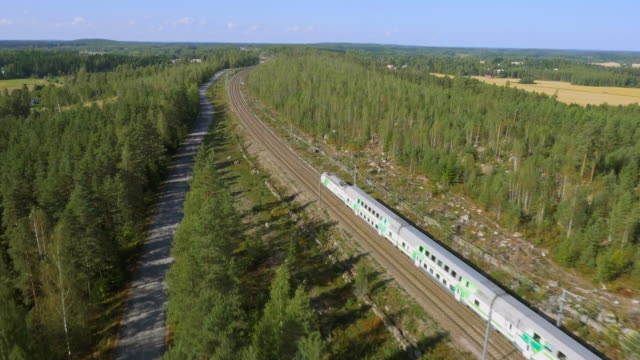 a train passing by at full speed, finland - finlandia video stock e b–roll