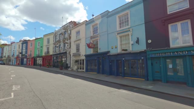 a view of a deserted portobello road on market day on may 02, 2020 in london, england. the uk remains in full lockdown due to the coronavirus... - anxiety stock videos & royalty-free footage