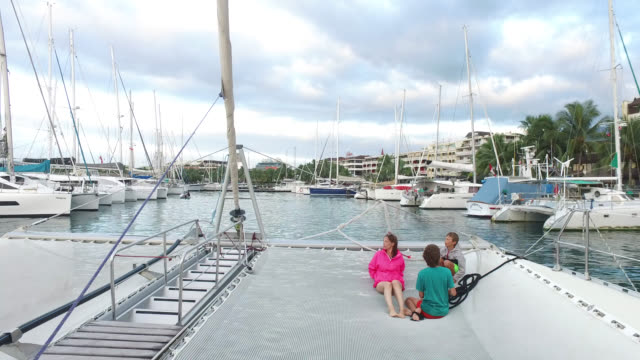 a woman and two children on a boat, sailboats - tahiti video stock e b–roll