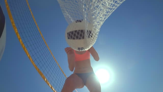 pov of a woman beach volleyball player putting the balls in a bag. - slow motion - beach bag stock videos and b-roll footage