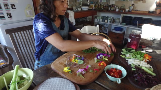 a woman foraging and preparing natural food. - foraging stock videos & royalty-free footage