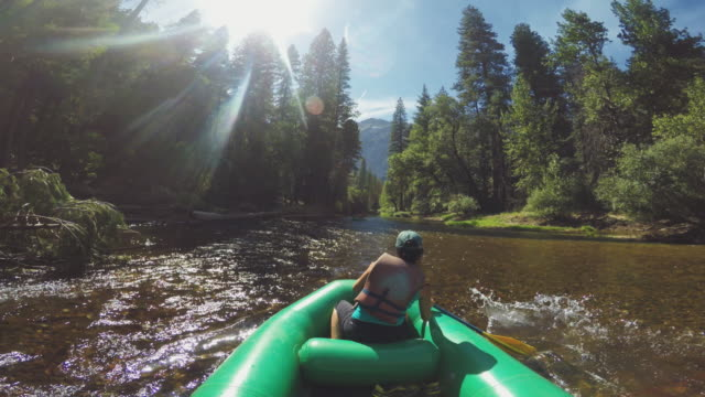 pov of a woman rafting in merced river of yosemite - river merced stock videos & royalty-free footage