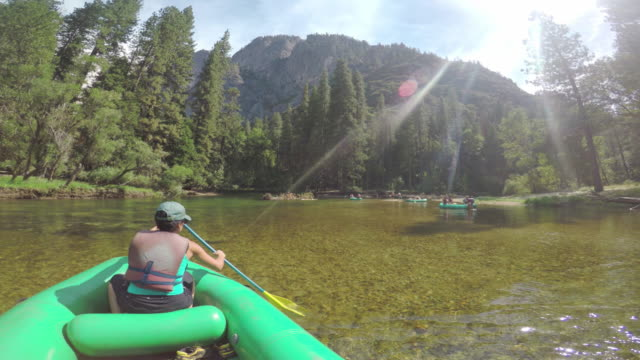 pov of a woman rafting in merced river of yosemite - merced river stock videos & royalty-free footage