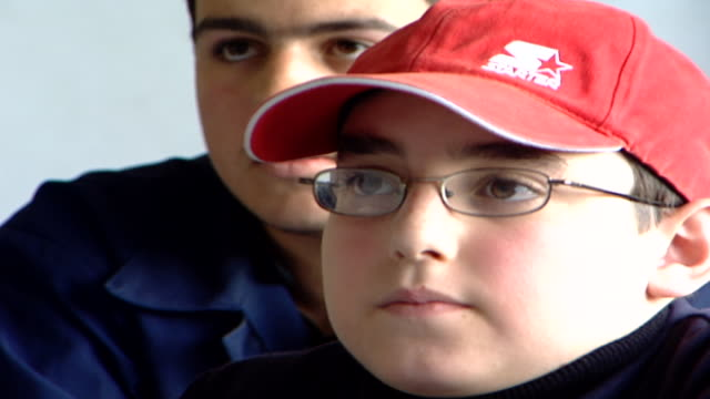 of a young druze boy's face wearing a red baseball hat, with his hand raised. irfan is a druze religious school with five branches across lebanon. - theology stock videos & royalty-free footage
