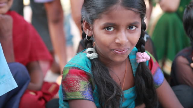 CU of a young girl in with pigtails that is belonging to the Devadasi lit female servant of deva in a village near Bijapur on March 30 2013 in...