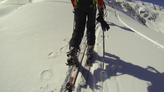 pov of a young man cross-country skiing with friends. - winter sport stock videos and b-roll footage
