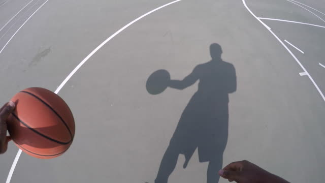 pov of a young man dribbling street basketball. - basketball ball stock videos & royalty-free footage