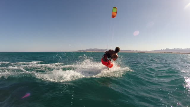 pov of a young man kite surfing in egypt. - slow motion - filmed in soma bay, egypt, africa - kiteboarding stock videos & royalty-free footage