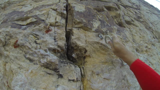 pov of a young man rock climbing. - wearable camera stock videos & royalty-free footage