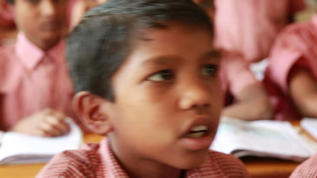 CU of a young schoolboy during class of a dropout school on March 29 2013 in Bijapur India The dropout school was founded in addition to the official...