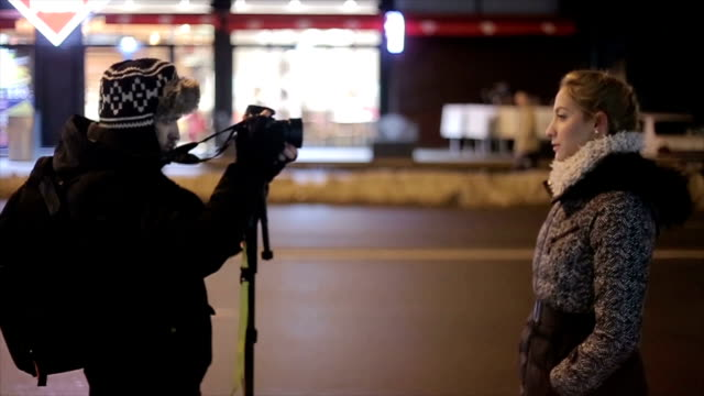 a young woman gives an interview on the street - microphone stock videos & royalty-free footage