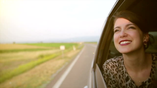 a young woman travels on vacation - car interior stock videos & royalty-free footage