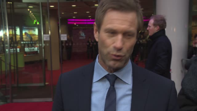 INTERVIEW Aaron Eckhart on Gerard Butler how the film will come across what audiences can expect at 'Olympus Has Fallen' UK Premiere at BFI IMAX on...