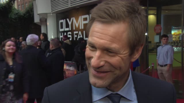 INTERVIEW Aaron Eckhart on Gerard Butler's singing his Scottish accent at 'Olympus Has Fallen' UK Premiere at BFI IMAX on April 03 2013 in London...