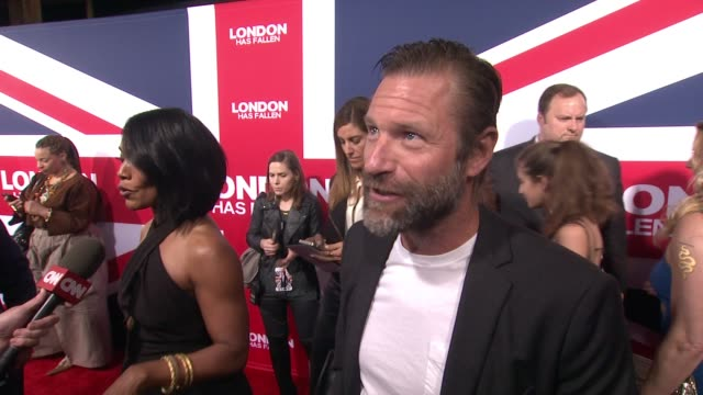 interview aaron eckhart on how the scale of the movie is bigger than before the most exciting films for him to film and how director babak najafi... - cinerama dome hollywood stock videos and b-roll footage