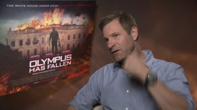 INTERVIEW Aaron Eckhart on the audiences reaction and on the movie's themes at the 'Olympus Has Fallen' Junket Interviews at Corinthia Hotel London...