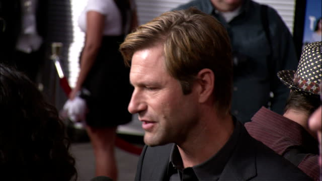 HA MCU Aaron Eckhart talking to reporter on the red carpet ZO to include Alan Ball interviewing next to Eckhart