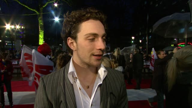 aaron johnson on his experience of premieres on wearing the green outfit for the first time on why this comic book story is different from other... - kick ass film title stock videos & royalty-free footage