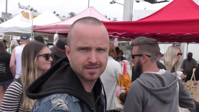 vídeos de stock, filmes e b-roll de interview aaron paul talks about his favorite price is right game while shopping at the farmers market in studio city in celebrity sightings in los... - game show