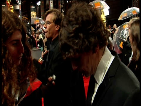 aaron sorkin, jessie eisenberg at the orange british academy film awards 2011 at london england. - ブランド名点の映像素材/bロール