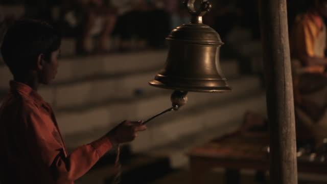 ms pan aarti puja prayer ceremony at ganges / varanasi, india - bell stock videos & royalty-free footage