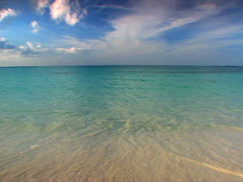 abaco: waves lapping sand on treasure cay beach - artbeats stock videos & royalty-free footage