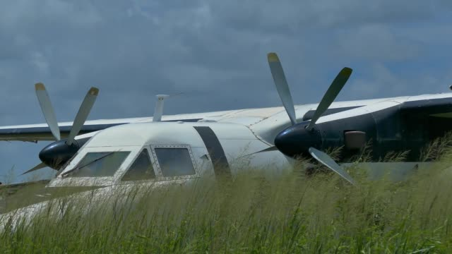 abandoned airplane. out of service at an airfield plane landfill. environmental issues. - abandoned stock videos & royalty-free footage