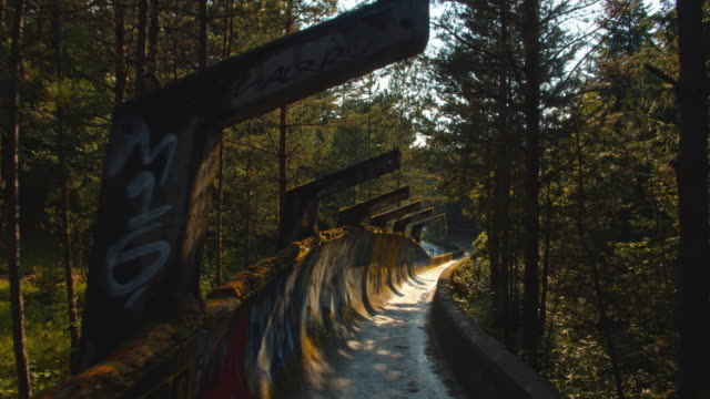 pov abandoned bobsled track at mount trebevic - bobsleighing stock videos & royalty-free footage
