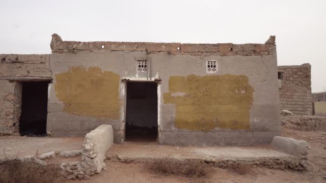 Abandoned building in Ras al-Khaimah village, trucking shot