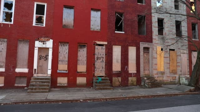 Abandoned buildings stand in a neighborhood with a high murder rate on February 3 2018 in Baltimore Maryland Baltimore one of the poorest major...