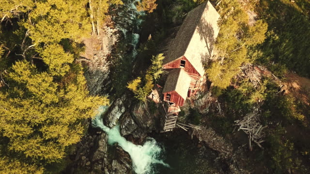 abandoned cabin with waterfall in colorado - cottage stock videos & royalty-free footage