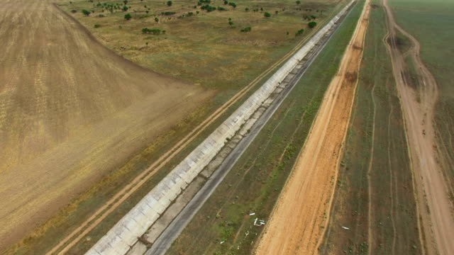 aerial: abandoned canal of irrigation system - sea channel stock videos and b-roll footage