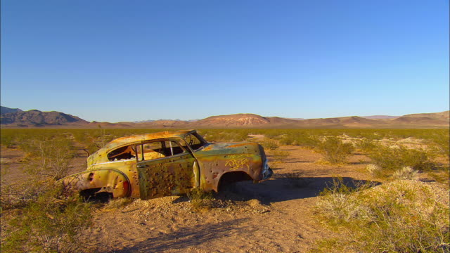 WS, Abandoned car on desert near Jackass, Nevada, USA