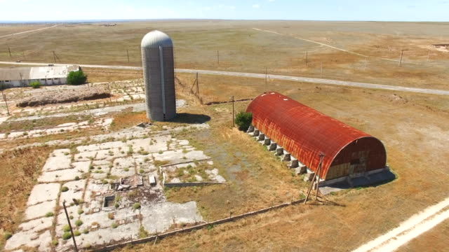 aerial: abandoned grain storage bin and grain elevator - elevator point of view stock videos and b-roll footage
