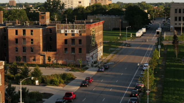 abandoned hotel in detroit during golden hour. view from above. next to michigan central station - detroit michigan stock videos & royalty-free footage
