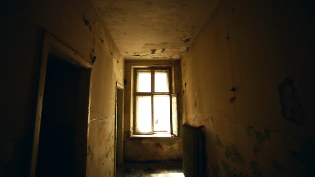 Abandoned house. Old room with window interior
