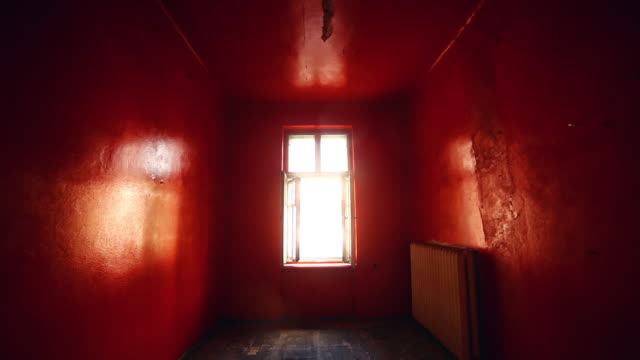 abandoned house. red old room with window - domestic room stock videos & royalty-free footage