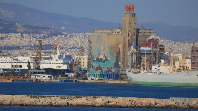stockvideo's en b-roll-footage met abandoned infrastructure of athens main harbor piraeus pictured during a ferry departure on august 8 2020 in athens greece first port and main... - veerboothaven
