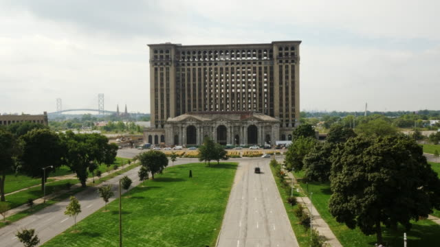 abandoned  michigan central station in detroit. view from above. before retauration, without windows.  ambassador bridge in background - detroit michigan stock videos & royalty-free footage