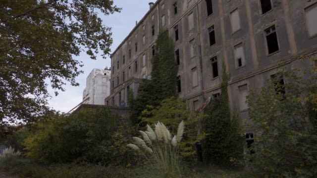 Abandoned place / lost place rice factory tracking shot external