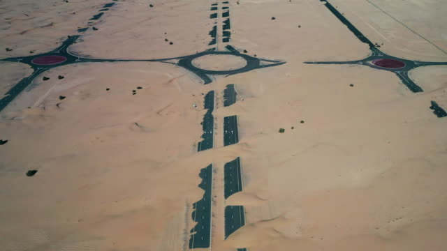 abandoned roads in the desert seen from flying overhead, dubai, united arab emirates - sand dune stock videos & royalty-free footage