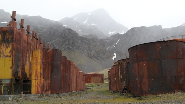 abandoned rusty whaling station buildings and mountains in snowfall - imperfection stock videos & royalty-free footage
