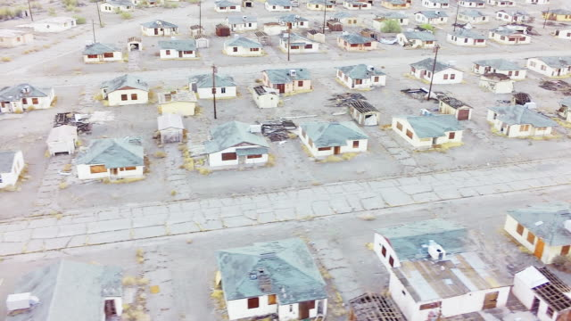 ws aerial abandoned town with rows of empty houses - recession stock videos & royalty-free footage