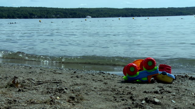abandoned toys on lakeshore - lakeshore stock videos & royalty-free footage