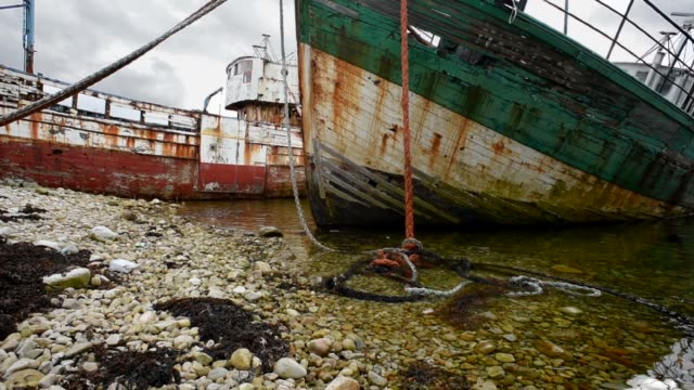 abandoned trawlers decaying on the beach-camaret sur mer. - trawler stock videos & royalty-free footage