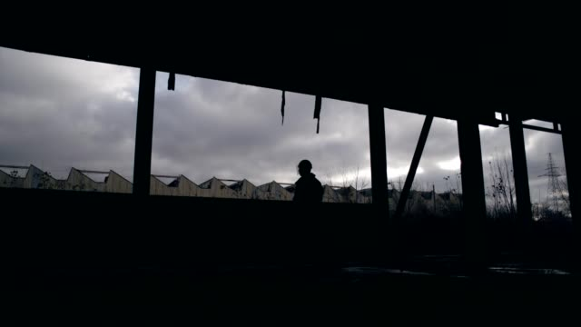 abandoned warehouse. polish martial law 1981. socialist militiaman on patrol - human rights stock videos & royalty-free footage